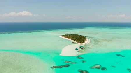 balabac : Seascape with beautiful beach and tropical island surrounded by a coral reef from above. Onok Island, Balabac, Philippines. Summer and travel vacation concept Stock Footage
