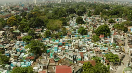 headstone : Famous cemetery in the city of Manila, where people live among the graves and crypts top view. Travel concept.