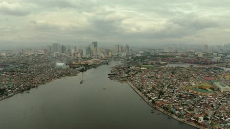 metro manila : The city of Manila, the capital of the Philippines. Modern metropolis, top view. Modern buildings in the city center.