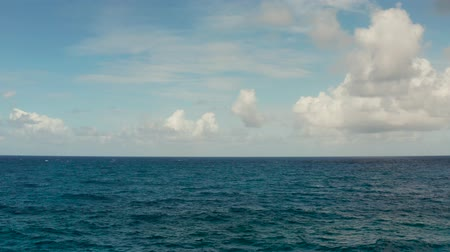 cloud scape : Blue ocean with waves and sky with clouds, seascape top view. Water cloud horizon background. Blue sea water with waves against sky. Stock Footage