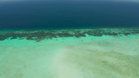 island hopping : Tropical islands and coral atolls with blue water of the sea, aerial view. Balabac, Palawan, Philippines. Summer and travel vacation concept. Stock Footage