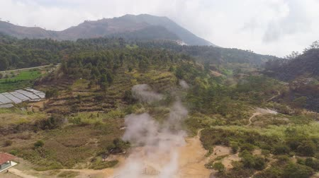 plateau : plateau with volcanic activity, mud volcano Kawah Sikidang, geothermal activity and geysers. aerial view volcanic landscape Dieng Plateau, Indonesia. Famous tourist destination of Sikidang Crater it still generates thick sulfur fumes.