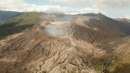 cratera : Crater with active volcano smoke in East Jawa, Indonesia. Aerial view of volcano crater Mount Gunung Bromo is an active volcano,Tengger Semeru National Park. 4K video. Aerial footage. Vídeos
