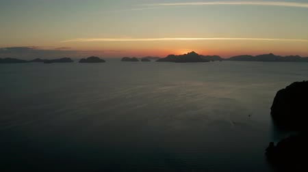 aerial view tropical sunset over the sea background of mountains. El nido, Philippines, Palawan. seascape with tropical islands at sunset time. Summer and travel vacation concept