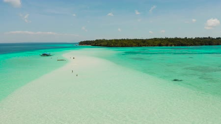 island hopping : Tropical landscape with a beautiful beach in the blue water and an island with coral reef and atoll. Mansalangan sandbar, Balabac, Palawan, Philippines. Summer and travel vacation concept Stock Footage