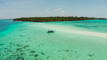 island hopping : White sandy beach in the lagoon with turquoise water on a tropical island. Mansalangan sandbar. Beach at the atoll. Summer and travel vacation concept. Balabac, Palawan, Philippines. Stock Footage