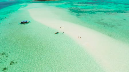 island hopping : Travel concept: sandy beach on a tropical island by coral reef atoll from above. Mansalangan sandbar, Balabac, Palawan, Philippines. Summer and travel vacation concept