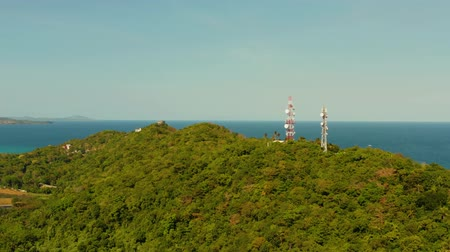 Telecommunication tower, communication antenna in tropical island aerial view. Repeaters on a metal tower. Boracay, Philippines