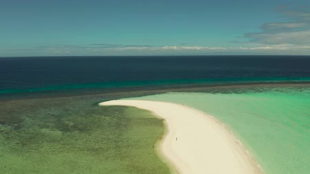 island hopping : Sandy white island with beach and sandy bar in the turquoise atoll water, aerial drone. Sandbar Atoll. Tropical island and coral reef. Summer and travel vacation concept, Camiguin, Philippines.