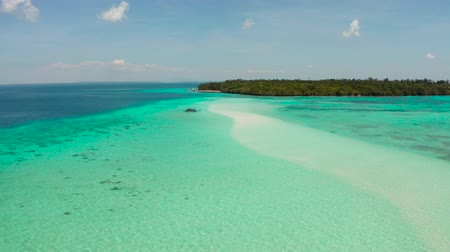 island hopping : Seascape with a beautiful beach and tropical island surrounded by a coral atoll with turquoise water. Mansalangan sandbar. Summer and travel vacation concept. Balabac, Palawan, Philippines.