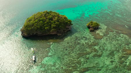 white sand : Turquoise lagoon with rocky island and corall reef, aerial view Boracay, Philippines. Summer and travel vacation concept. Stock Footage