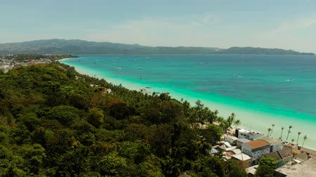 boracay : Tropical white sand beach, hotels near the blue lagoon and corall reef. aerial view, Boracay, Philippines. Seascape with beach on tropical island. Summer and travel vacation concept.