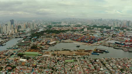 metro manila : Sea port on the background of the city of Manila with skyscrapers and modern buildings. Modern buildings in the city center.