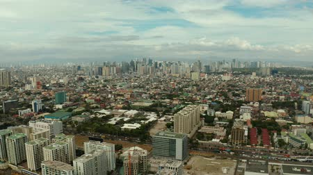 metro manila : Cityscape of Manila with skyscrapers, modern buildings and business centers, top view. Modern buildings in the city center. Stock Footage