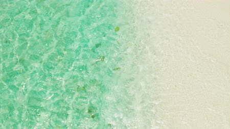 island hopping : Sandy beach with and azure water of the lagoon,copy space for text, top view. Sea water surface in lagoon. Transparent turquoise ocean water surface. Background texture