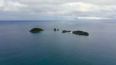 island hopping : Tropical islands and blue sea, from above. Caramoan Islands, Philippines. Rocky islands with trees.