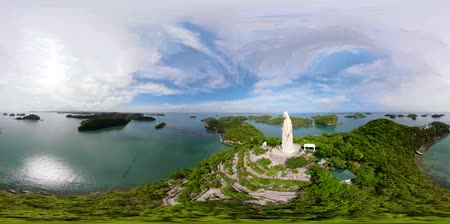 cem : Statue of Jesus Christ on Pilgrimage island in Hundred Islands National Park, Pangasinan, Philippines. VR 360. Aerial view of group of small islands with beaches and lagoons, famous tourist attraction, Alaminos.