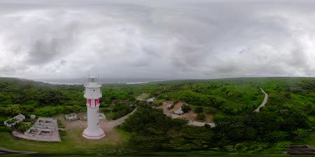 gyrophare : Bolinao Lighthouse, Luzon, Philippines. VR 360. Lighthouse on a hill near the sea. Summer and travel vacation concept.
