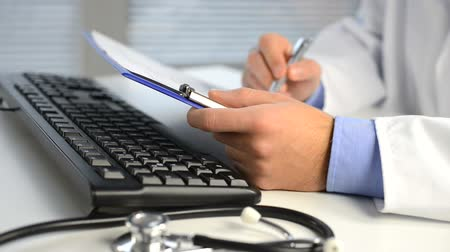 closeup of male doctor hands typing on keyboard Wideo