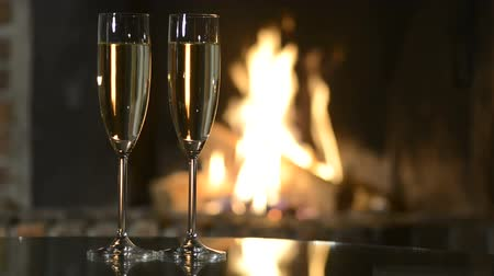 valentin nap : Two champagne glasses in front of fireplace