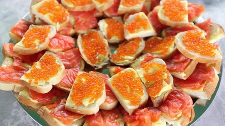fumado : sandwiches with butter, salmon and red caviar. Festive table in Russia