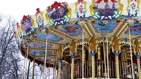 kolotoč : beautiful round childrens carousel is spinning in an amusement park HD