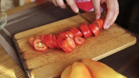 blanching : Girl Chef cuts the tomato in the kitchen. Cooking homemade pizza