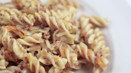 spagetti : pasta with minced meat in Italian. hot pasta spirals with minced meat, close-up