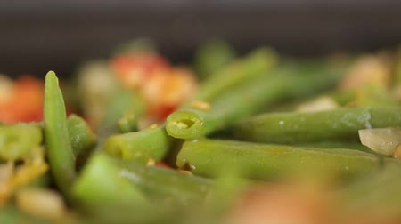 peas : Chopped beans fried in a frying pan with tomatoes and onions