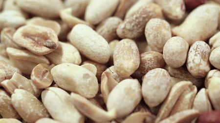 proteínas : a lot of peanuts peeled without husks, close-up Vídeos