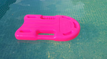 rescuer : pink plastic rescue buoy in the pool with clean water
