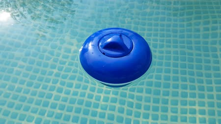 blue plastic cleaning filter in the pool with water