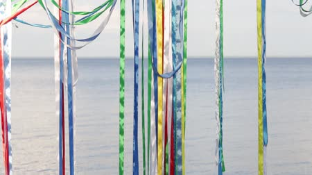 colorful ribbons on the background of water. traditional celebrations