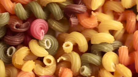 multi-colored pasta as a background close-up. place for text