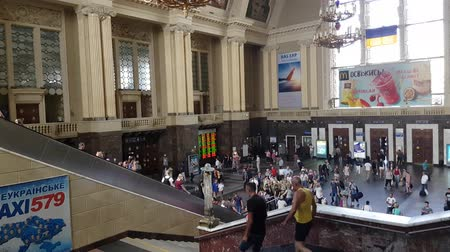inside the central Kiev railway station. people come to the station, climb and descend the escalator. Ukraine, Kiev. July 19, 2018