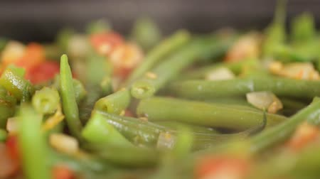 asparagus beans with vegetables in a pan. cooking healthy vegetarian dishes