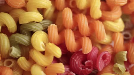 raw colorful pasta close up as background. traditional italian food. space for text Стоковые видеозаписи