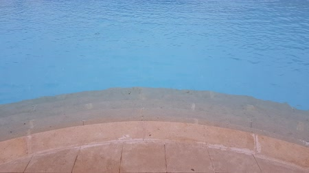 steps lead to the pool. on the water easy ripples. summer relaxing holiday by the water