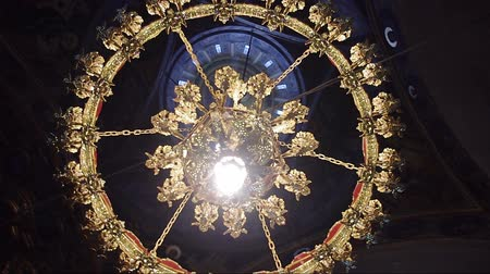 церковь : a chandelier inside an Orthodox church
