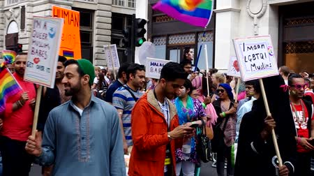 muslim leader : London, United Kingdom. 25 June, 2016. A group of asian muslim LGBT with banners at London Pride Parade.