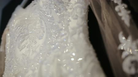 coudre : Close-up of wedding dress with sparkles, lace of a wedding dress