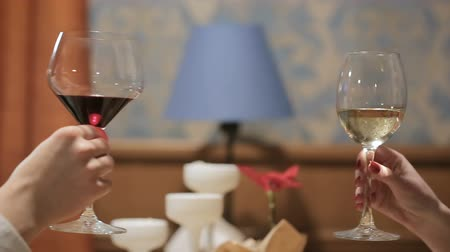 knock : Young couple toasting with wine glass and champagne in a restaurant. Two people toasting in a party Stock Footage