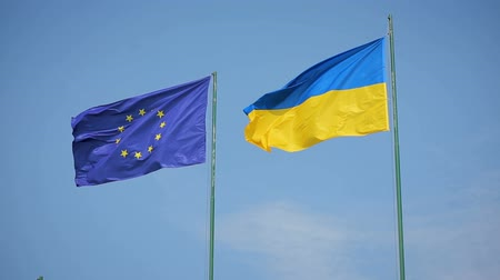 mastro de bandeira : Flag of Ukraine and flag of European Union fluttering on a background of a blue sky