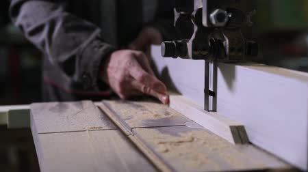 bandsaw : Close-up of a carpenters hand working on an electric band saw