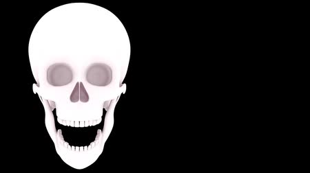 head over : skull over black Stock Footage