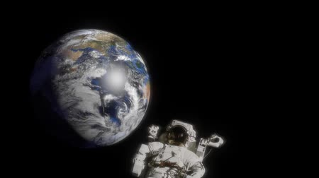 mekik : Astronaut floating in the space without gravity. Planet Earth rotating on background. Cosmonaut spacewalk. Spaceman mission.