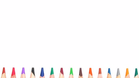Multicolored pencils over a white background. Back to school concept Stock mozgókép