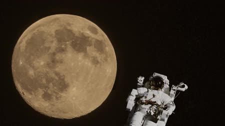 Astronaut floating in the space without gravity. A big moon on background. Cosmonaut spacewalk. Spaceman mission