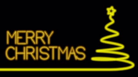 Merry christmas made with neon light in glowing yellow