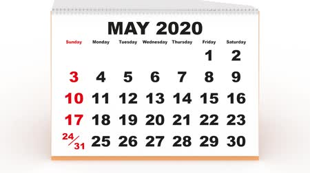 yıllık : monthly sheets passing in the calendar desk for 2020. new year 2020 calendar in english. Week starts on sunday Stok Video